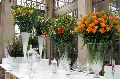 Lily arrangements being prepared for the display